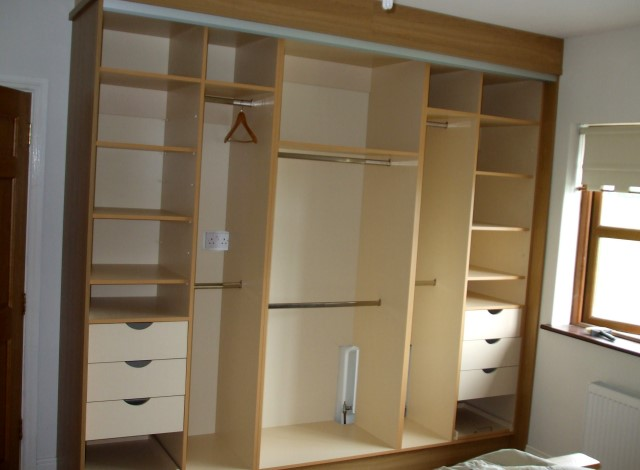 Interior of three door sliding wardrobe at Corofin