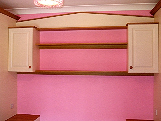 Open Shelving and Cabinets above Bed